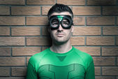 Superhero looking up — Stock Photo