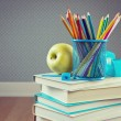 Pencils with apple and stack of books — Stock Photo #56592625
