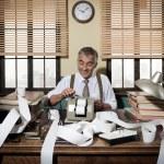 Accountant with adding machine — Stock Photo #56598485