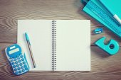 Open notebook with colorful stationery — Stock Photo