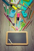 Stationery on  floor moving towards blackboard — Stock fotografie