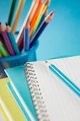 Multicolor pencils, notebook and textbooks — Stock Photo