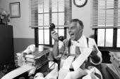 Angry  businessman shouting at phone — Stock Photo