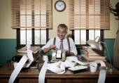 Accountant with adding machine — Stock Photo