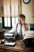 Reporter working at office desk — Stock Photo