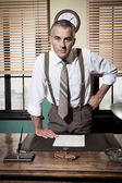 Businessman with arms akimbo — Stock Photo