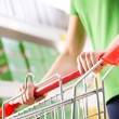 Woman shopping at supermarket — Stock Photo #56624525