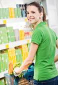 Woman shopping at supermarket — Stock Photo