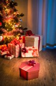 Christmas eve night with colorful gifts — Stock Photo