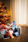 Christmas tree with gift boxes — Stock Photo