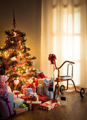 Gift boxes and retro tricycle — Stock Photo