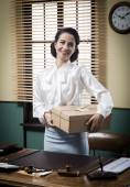 Secretary holding mail package — Stock Photo