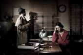 Detective interviewing woman — Stock Photo