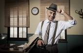Smiling businessman leaving office — Stock Photo