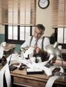 Accountant with adding machine — Stock Photo