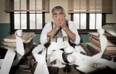 Desperate accountant with head in hands — Stock Photo