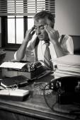 Exhausted reporter with headache — Stock Photo