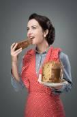 Woman eating panettone — Stock Photo
