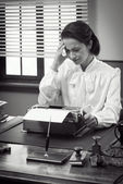 Vintage secretary with headache — Foto Stock
