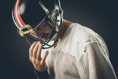 Football player with helmet — Stock Photo