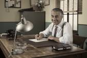 Director at desk signing document — Stockfoto