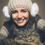 Beautiful woman with cat — Stock Photo #63438297