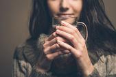 Beatiful woman having hot drink — Stock Photo