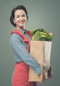 Woman holding shopping grocery bag — Stock Photo