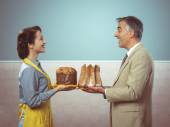 Smiling couple with cakes — Stock Photo