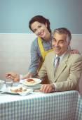 Woman serving lunch to husband — Stock Photo