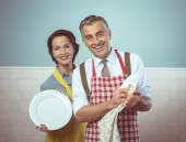 Couple dish washing together — Stock Photo