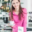 Постер, плакат: Waitress serving hot espresso