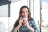 Girl having a coffee break — Stock Photo