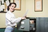 Vintage secretary searching files — Stock Photo