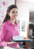 Waitress in pink shirt serving coffee — Foto Stock
