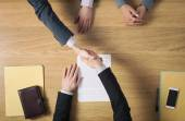 Business people handshaking after signing an agreement — Stock Photo