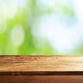 Empty table  with blurred green background — Zdjęcie stockowe