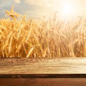 Empty table on wheat field — Stock Photo