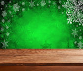 Empty  table with green christmas background — Stock Photo
