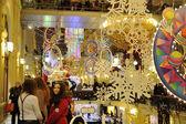 Christmas illuminations, decorations and girls — Stock Photo