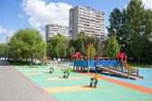 Playground and residential buildings — Stock Photo
