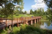 Wooden bridge and Chermyanka river — Stock Photo