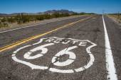 Long road with a Route 66 sign painted on it — Stock Photo