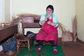 Woman is making reed furniture in a braiding factory at Madeira, Portugal. — Stock Photo