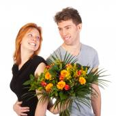 Man and woman standing backwards with a beautiful bunch of flowers — Stock Photo