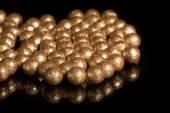Gilded balls on a black background — Stock Photo