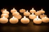 Several white candles at a black background — Foto de Stock