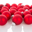 Red Christmas balls isolated at a white background — Stock Photo #59308227