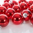 Red Christmas balls isolated at a white background — Stock Photo #59308231