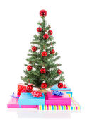 Christmas tree with red balls and gifts isolated at white — Stock Photo